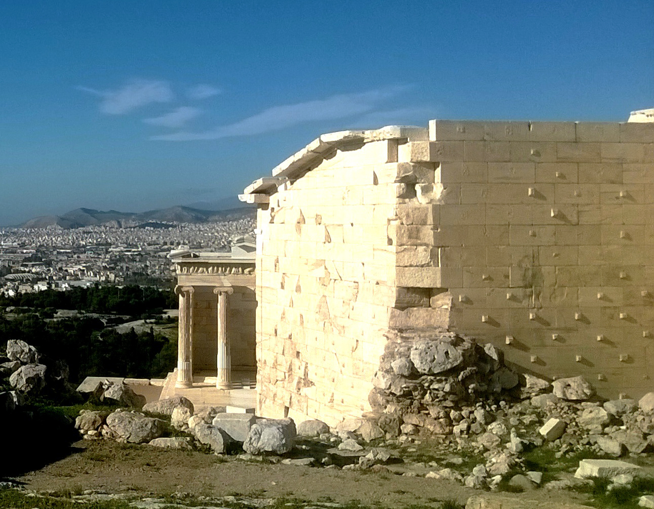 Small square protrusions, known as ancones, can be seen at the rear wall of Acropolis' monumental gateway